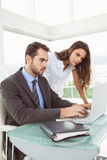 Business people using laptop in office Royalty Free Stock Images