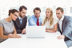 Business people using laptop in office Stock Photo