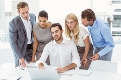 Business people using laptop at office Royalty Free Stock Images