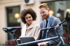 Business people using laptop at outdoor. Business and coworker concept Stock Images