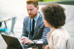 Business people using laptop outdoor. Business and coworker concept Royalty Free Stock Images