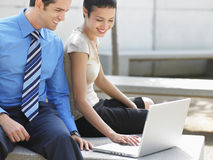 Business People Using Laptop Outside Office Stock Photos