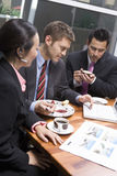 Business People Using Laptop During Their Coffee Break Stock Image