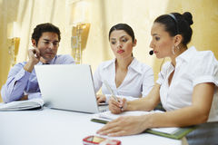 Business People Using Laptop Together Stock Photos