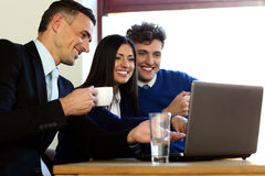 Business people using laptop together Stock Photography