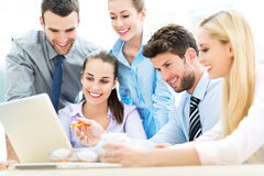 Business people using laptop together Stock Image