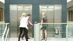 Business people using a lift in building Stock Images