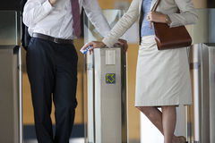 Business people using mass transit turnstile Royalty Free Stock Photography