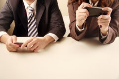 Business people using mobile phones Stock Images