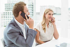 Business people using mobile phones Royalty Free Stock Photography