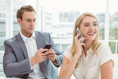 Business people using mobile phones Stock Image