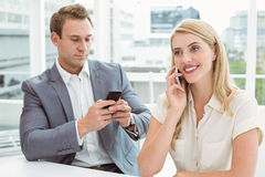 Business people using mobile phones Stock Photo