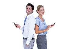 Business people using smartphone back to back Stock Photo