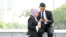 Business people using smartphone. Outside office stock footage