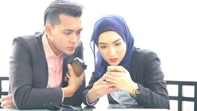 Business people using smartphone. At cafe stock footage