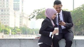Business people using smartphone. Outside office stock video
