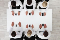 Business people using smartphones Stock Photography