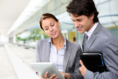Business people using tablet Royalty Free Stock Image