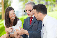 Business people using a tablet Stock Photo