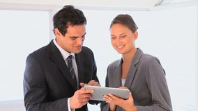 Business people using a tablet computer stock video footage
