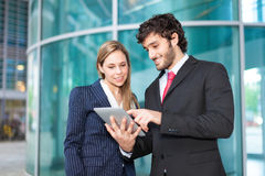 Business people using a tablet Stock Image