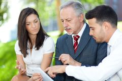 Business People using a tablet Royalty Free Stock Image
