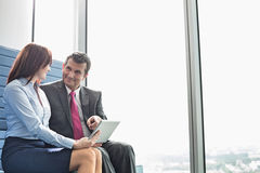 Business people using tablet PC in office Stock Images