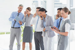 Business people using their phone Stock Photo