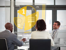 Business people using yellow pie chart interface Royalty Free Stock Photography