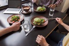 Business people in vegan restaurant Stock Images