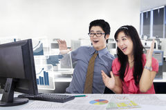 Business people with virtual charts in the office Royalty Free Stock Images