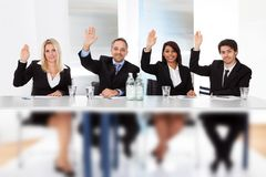 Business people voting at the meeting royalty free stock photo