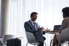 Business people waiting at airport lounge Royalty Free Stock Photo