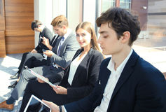 Business people waiting for the job interview. Business people waiting for the job interview Royalty Free Stock Image