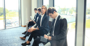 Business people waiting for the job interview. Business people waiting for the job interview Stock Photos