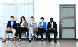 Business people waiting for job interview. Five candidates competing for one position Royalty Free Stock Image