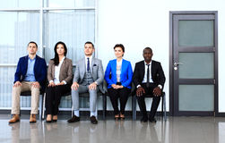 Business people waiting for job interview. Five candidates competing for one position Stock Photo