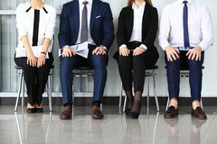 Business people waiting for job interview. Four candidates competing for one position royalty free stock image