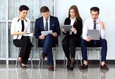 Business people waiting for job interview. Four candidates competing for one position Royalty Free Stock Images