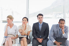 Business people waiting for job interview in office. Four business people waiting for job interview in a bright office Stock Images