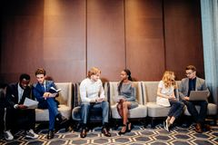 Business people waiting for job interview, talking. And smiling Stock Image