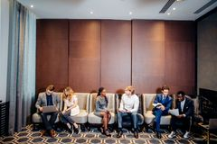 Business people waiting for job interview, talking. And smiling Royalty Free Stock Photo