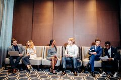 Business people waiting for job interview, talking. And smiling Stock Photos