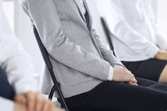 Business people waiting for job interviews or taking part at conference in office, close-up. Women sitting on chairs. Like at queue or meeting stock images