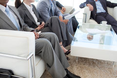 Business people in a waiting room Royalty Free Stock Images