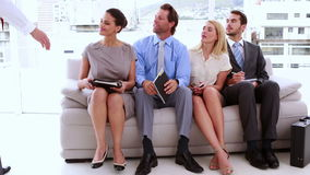 Business people waiting to be called into interview stock video