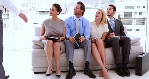 Business people waiting to be called into interview stock video footage