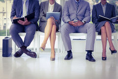 Business people waiting to be called into interview Royalty Free Stock Image