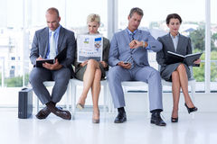 Business people waiting to be called into interview Stock Photos