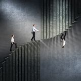 The different vision. Business people walk on abstract concrete stair one of them goes in the opposite direction royalty free stock images